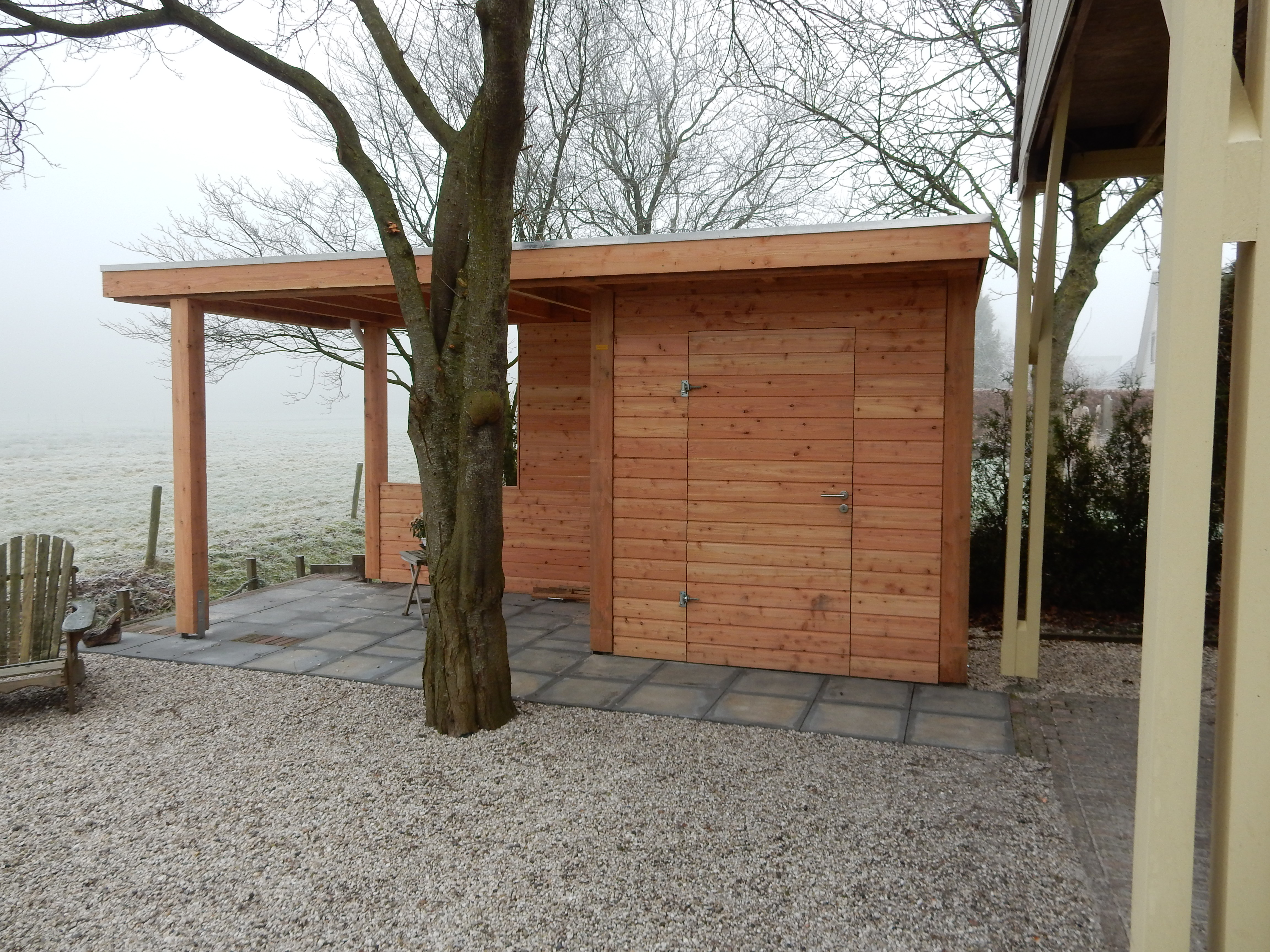 Overkapping berging in roden welles hout